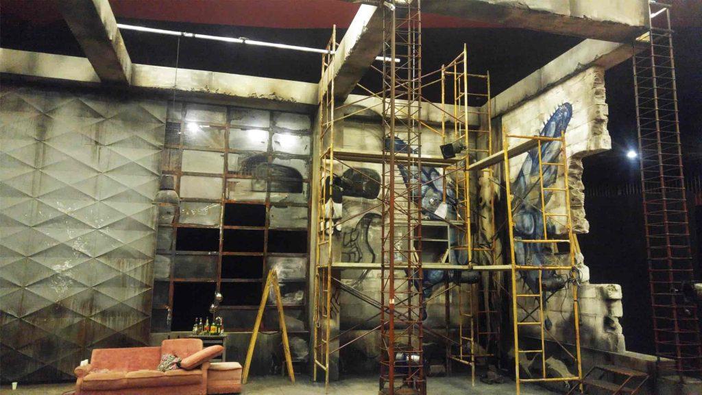 theater decor Romeo Juliet scaffolding wall sofa