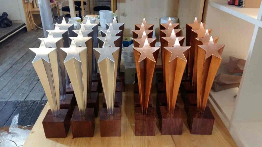props - star-shaped trophies - gold and copper