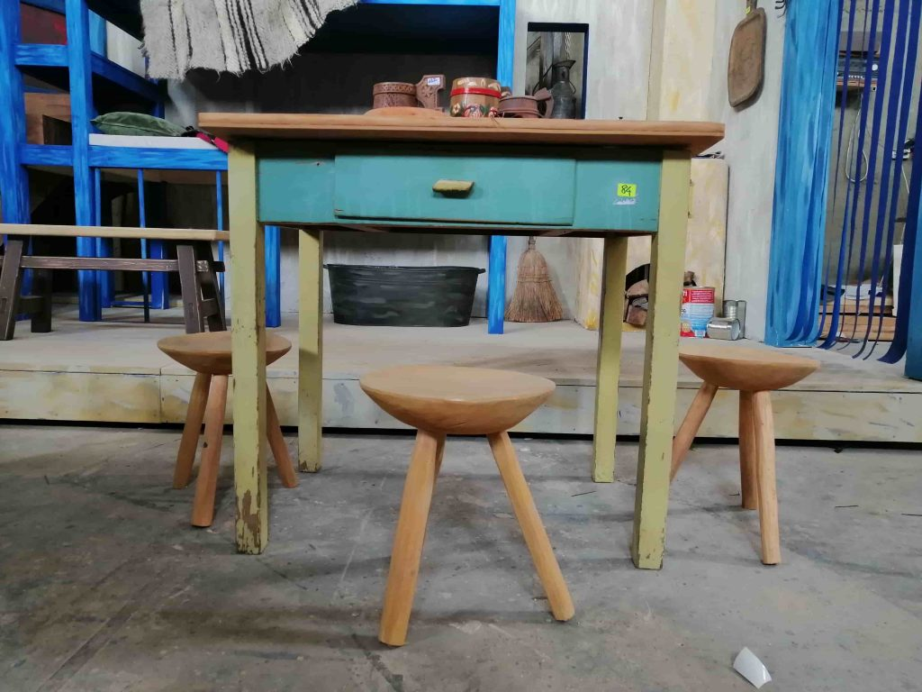 theater carpentry - vintage table with round wooden chairs